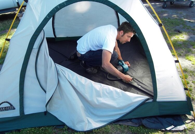 Setting up your tent to let it dry is my preferred method. Also allows for vaccuming.