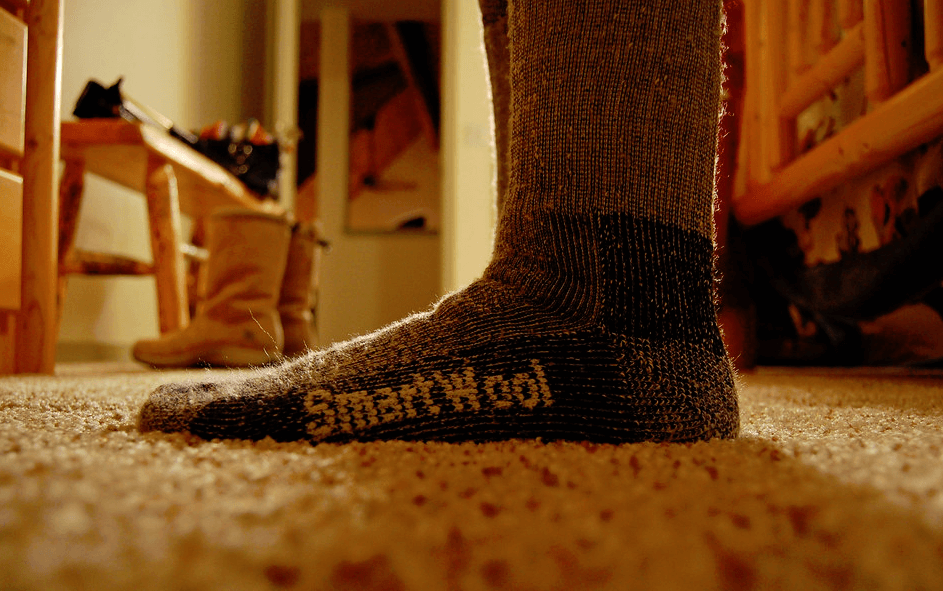 Putting on the Smartwool hiking socks before an outdoor adventure