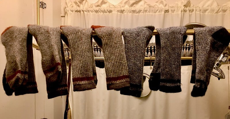 All of the smartwool socks hanging to dry